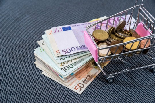 shopping-cart-filled-with-euro-coin-with-euro-bills-picture-id660701186